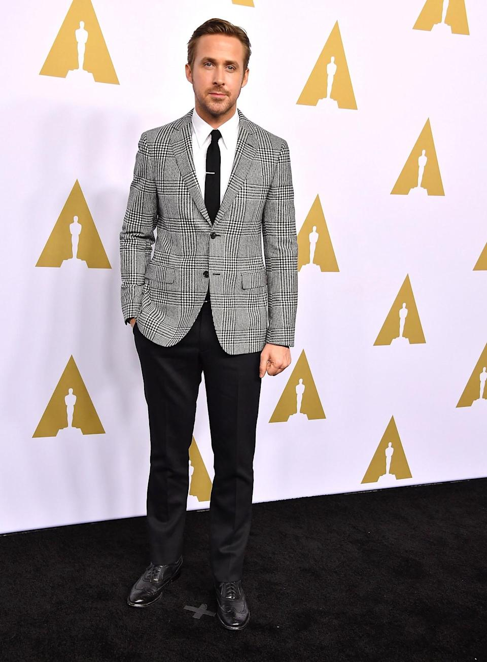 <p>The one and only Ryan Gosling looked very dapper, as per usual. Wearing a checked blazer by Salvatore Ferragamo. [Photo: Getty] </p>