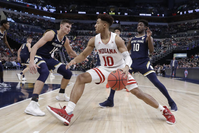 Indiana's Rob Phinisee (10) goes to the basket against Notre Dame's Nate Laszewski (14) and TJ Gibbs (10) during the second half of an NCAA college basketball game, Saturday, Dec. 21, 2019. Indiana won 62-60 (AP Photo/Darron Cummings)