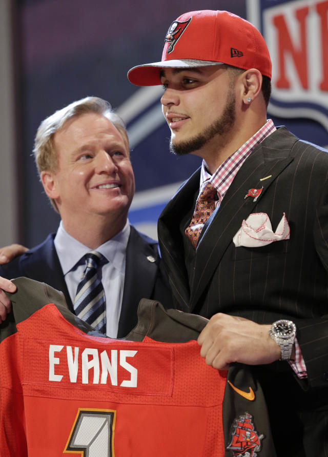 Texas A&M wide receiver Mike Evans poses with NFL commissioner after being chosen by the Tampa Bay Buccaneers as the seventh pick in the first round of the 2014 NFL Draft, Thursday, May 8, 2014, in New York.(AP Photo/Craig Ruttle)