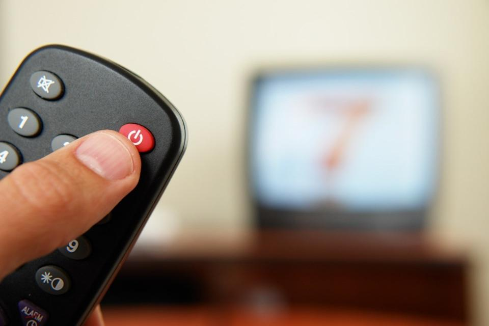 person turning off tv