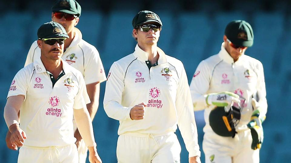 David Warner, Steve Smith and Tim Paine, pictured here leaving the field after their draw with India.
