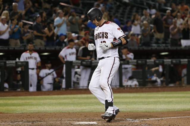 Arizona Diamondbacks' Carson Kelly crosses home plate after hitting a home run against the Colorado Rockies in the eighth inning of a baseball game, Monday, Aug. 19, 2019, in Phoenix. (AP Photo/Rick Scuteri)