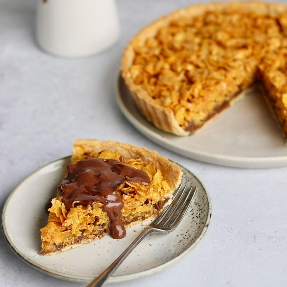 """<p>A pastry base topped with <a href=""""https://www.delish.com/uk/cooking/recipes/a33230544/fig-jam-recipe/"""" rel=""""nofollow noopener"""" target=""""_blank"""" data-ylk=""""slk:jam"""" class=""""link rapid-noclick-resp"""">jam</a> then piled high with sweetened cornflakes, it was a <a href=""""https://www.delish.com/uk/food-news/g33562156/school-dinners/"""" rel=""""nofollow noopener"""" target=""""_blank"""" data-ylk=""""slk:school dinner"""" class=""""link rapid-noclick-resp"""">school dinner</a> staple. Our cornflake tart has had a little upgrade, swapping jam for <a href=""""https://www.delish.com/uk/cooking/recipes/a35403622/nutella-stuffed-pancakes-recipe/"""" rel=""""nofollow noopener"""" target=""""_blank"""" data-ylk=""""slk:Nutella"""" class=""""link rapid-noclick-resp"""">Nutella</a>, and the beautiful addition of chocolate <a href=""""https://www.delish.com/uk/cooking/recipes/a29320067/custard-banana-bread/"""" rel=""""nofollow noopener"""" target=""""_blank"""" data-ylk=""""slk:custard"""" class=""""link rapid-noclick-resp"""">custard</a>, because C'MON you can't get more nostalgic than that! </p><p>Get the <a href=""""https://www.delish.com/uk/cooking/recipes/a35511244/cornflake-tart/"""" rel=""""nofollow noopener"""" target=""""_blank"""" data-ylk=""""slk:Cornflake Tart With Chocolate Milk Custard"""" class=""""link rapid-noclick-resp"""">Cornflake Tart With Chocolate Milk Custard</a> recipe.</p>"""