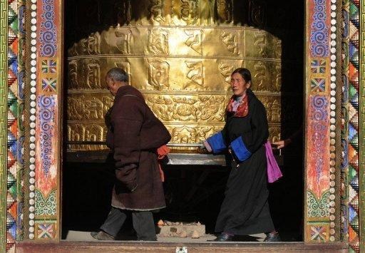 This file photo shows Tibetan pilgrims with a giant prayer wheel at a monastery in the town of Tongren, Qinghai Province, in 2008. China is ramping up security in Tibetan areas after a spate of self-immolation protests just as Beijing holds a key political gathering, local residents and overseas rights groups said on Friday