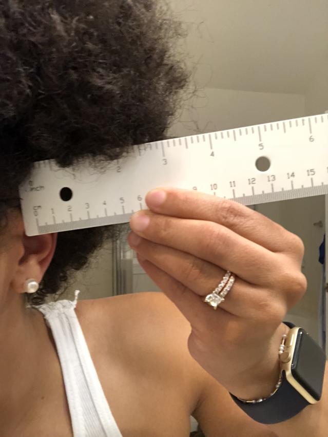 The nursing student measured her hair to prove that it met the school's guidelines. (Photo: Courtesy of Jade Payadue)