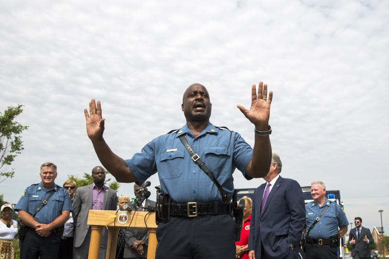 Captain Ron Johnson of the Missouri Highway Patrol addresses the media following an announcement that officer Darren Wilson had been involved in the shooting of teen, Michael Brown, in Ferguson, Missouri August 15, 2014. Police named Wilson as the officer who shot and killed unarmed black teenager Brown in Ferguson, Missouri, and said the youth was the key suspect in a robbery that occurred minutes before the shooting, which sparked days of sometimes violent protests. REUTERS/Lucas Jackson (UNITED STATES - Tags: CIVIL UNREST CRIME LAW)