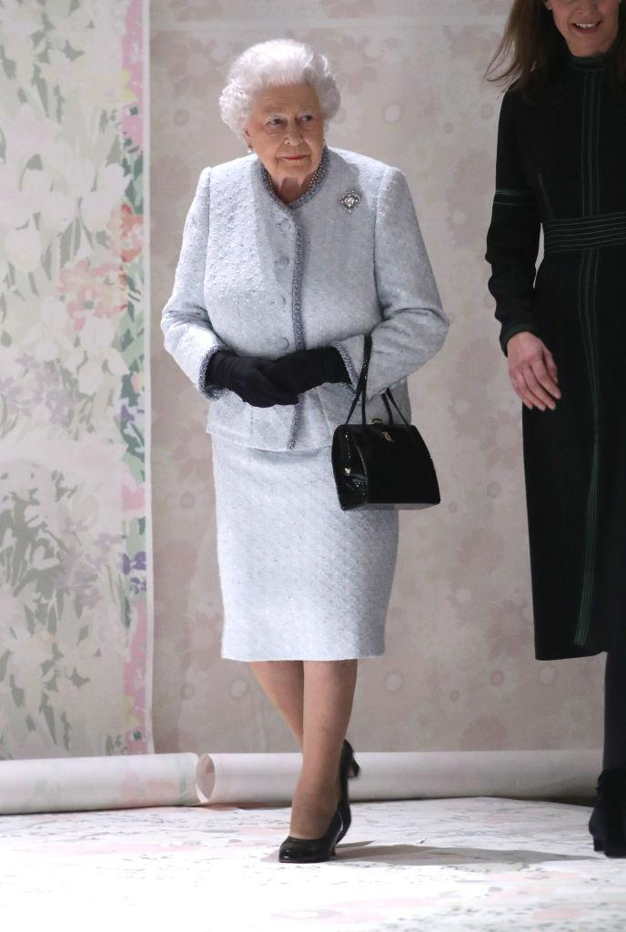 <p>For the Richard Quinn show, Her Majesty donned a powder blue co-ord and black miniature handbag. It's safe to say the fash pack's eyes were averted fom the runway when she took a seat on the FROW. <em>[Photo: Getty]</em> </p>
