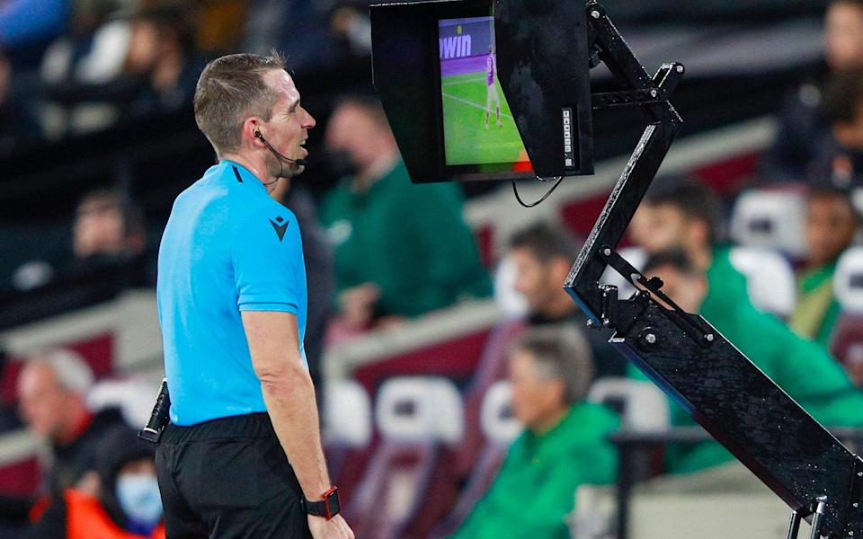Referee Tobias Stieler checks VAR during the Europa League Group H soccer match between West Ham and Rapid Vienna - AP