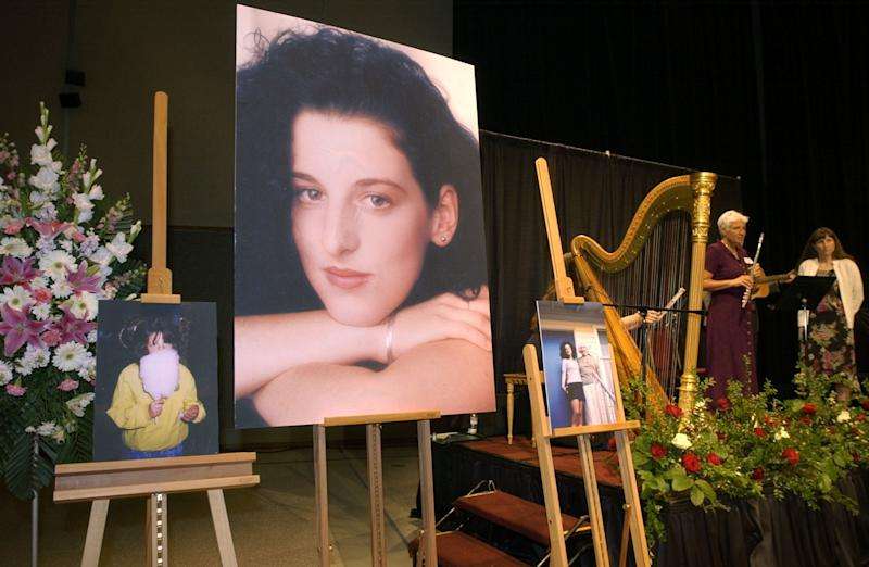 FILE - In this May 28, 2002 file photo taken at the Modesto Centre Plaza in Modesto, Calif. photos of Chandra Levy are on display as musicians, right, stand by at the memorial service for Levy. Jurors have begun a second day of deliberations Thursday, Nov.17, 2010 in the Chandra Levy murder trial.  (AP Photo/Debbie Noda, Pool, File)