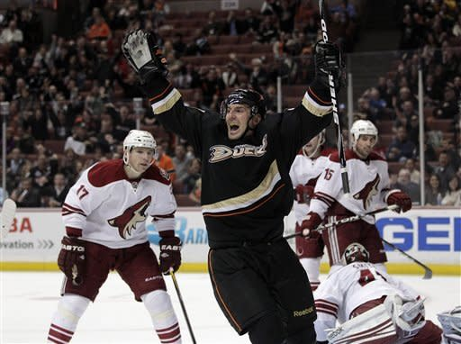 Anaheim Ducks defenseman Francois Beauchemin, center, celebrates after scoring a goal in the second period of an NHL hockey game against the Phoenix Coyotes in Anaheim, Calif., Wednesday, Jan. 18, 2012. (AP Photo/Jae C. Hong)