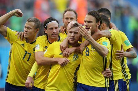 July 3, 2018; St. Petersburg, Russia; Sweden player Emil Forsberg (center) celebrates with teammates after scoring a goal against Switzerland in the round of 16 during the FIFA World Cup 2018 at St. Petersburg Stadium. Mandatory Credit: Wu Zhuang/Xinhua/Sipa USA via USA TODAY Sports