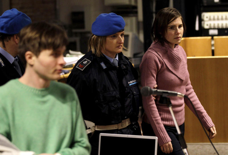 FILE - In this Saturday, Dec. 18, 2010 file photo U.S. student Amanda Knox, right, walks past Raffaele Sollecito, as she arrives after a break to attend a hearing in her appeals trial, at Perugia's courthouse, Italy. Italy's highest criminal court has overturned the acquittal of Amanda Knox and of her former Italian boyfriend, Raffaele Sollecito, in the slaying of her British roommate and ordered a new trial. The Court of Cassation ruled Tuesday, March 26, 2013 that an appeals court in Florence must re-hear the case against the American and her Italian-ex-boyfriend for the murder of 21-year-old Meredith Kercher   (AP Photo/Alessandra Tarantino)