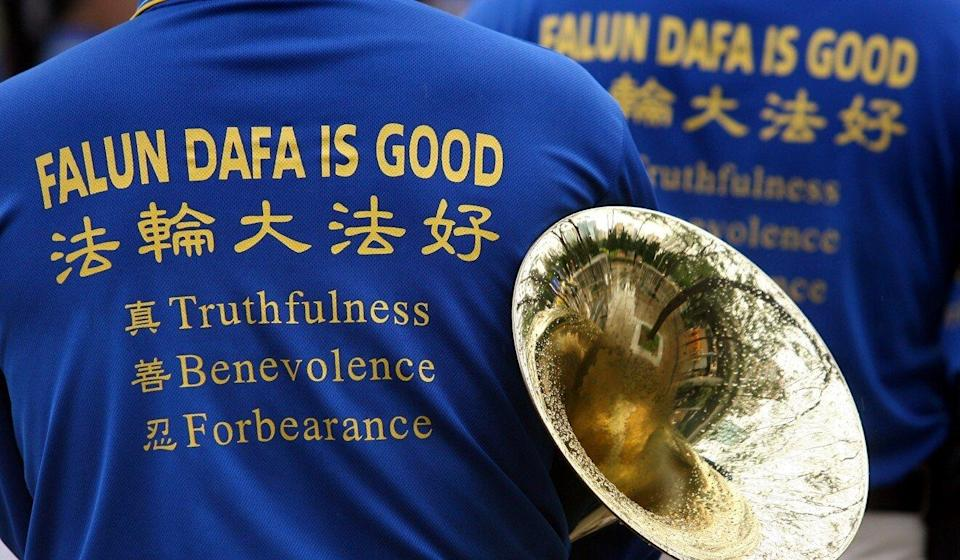 In April 2009, Falun Gong marched from Victoria Park to Beijing's liaison office in the city to protest alleged persecution at the hands of the Chinese government. Photo: Jonathan Wong