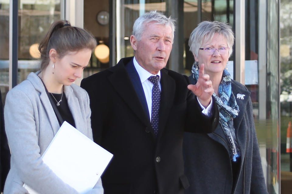 FILE - In this Aug. 22, 2019, file photo, lawyer Bernard Collaery, center, leaves the Australian Capital Territory Supreme Court in Canberra, Australia. A former Australian spy was released from court on Friday, June 18, 2021, with a three-month suspended prison sentence over his attempt to help East Timor prove that Australia spied on the fledgling nation during multi-billion dollar oil and gas negotiations. The former spy publicly known as Witness K and his lawyer Collaery had been charged in 2018 with conspiring to reveal secret information to the East Timorese government. (AP Photo/Rod McGuirk, File)