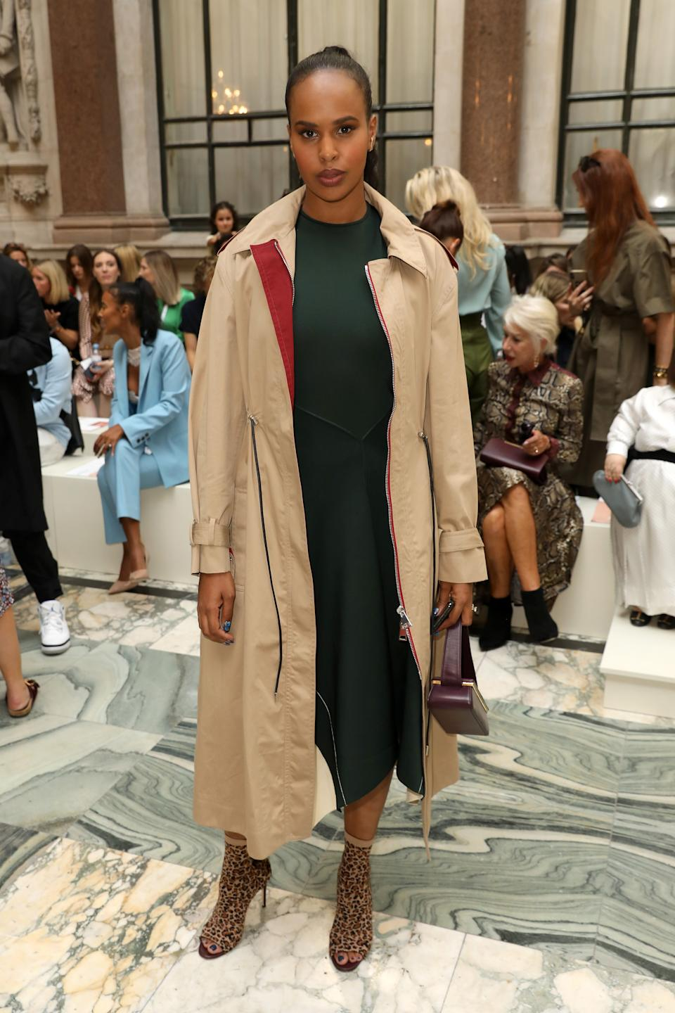 Sabrina Elba wore a trench coat and leopard print boots to the show [Photo: Getty]