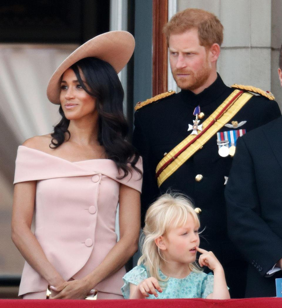 """<p>In one of her first big outings after <a href=""""https://www.townandcountrymag.com/society/tradition/g14522381/prince-harry-meghan-markle-royal-wedding-2018-photos/"""" rel=""""nofollow noopener"""" target=""""_blank"""" data-ylk=""""slk:marrying Prince Harry"""" class=""""link rapid-noclick-resp"""">marrying Prince Harry</a>, Meghan, Duchess of Sussex, joined the royal family on the Buckingham Palace balcony for Trooping the Colour in June 2018 wearing a blush pink dress and hat.</p>"""
