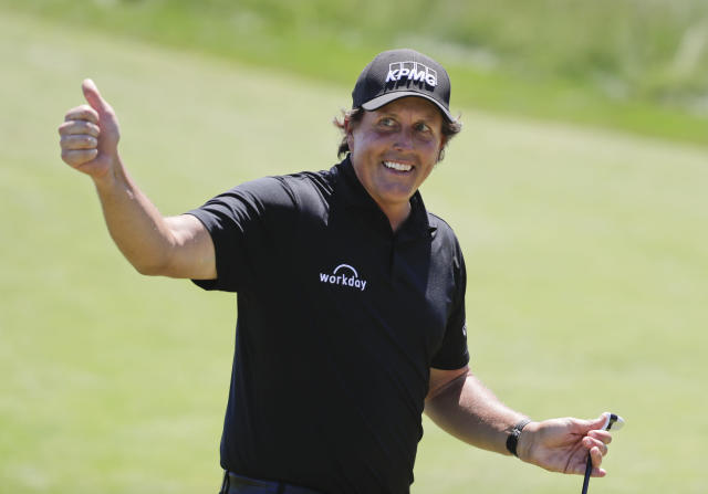 "A European golf pro put the ultimate trust in Phil Mickelson's short game, risking injury to allow ""Lefty"" to pull off a remarkable trick shot. (AP)"