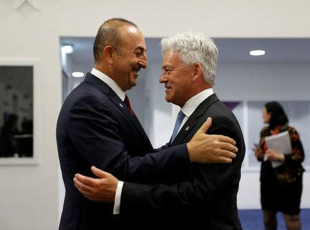 Turkey's Foreign Minister Mevlut Cavusoglu (L) talks with Alan Duncan, Britain's Minister of State for Europe and the Americas, before a meeting with European Union Foreign Ministers in Valletta, Malta, April 28, 2017.  REUTERS/Darrin Zammit Lupi