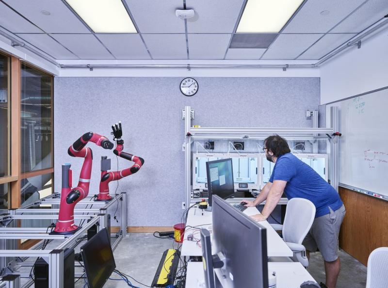 Facebook's AI Research lab, housed in a former conference room that overlooks an entrance to the company's headquarters, whirs with robot arms, legs, and 3-D printers (to prototype parts and playthings). | Photographed by Spencer Lowell for Fortune