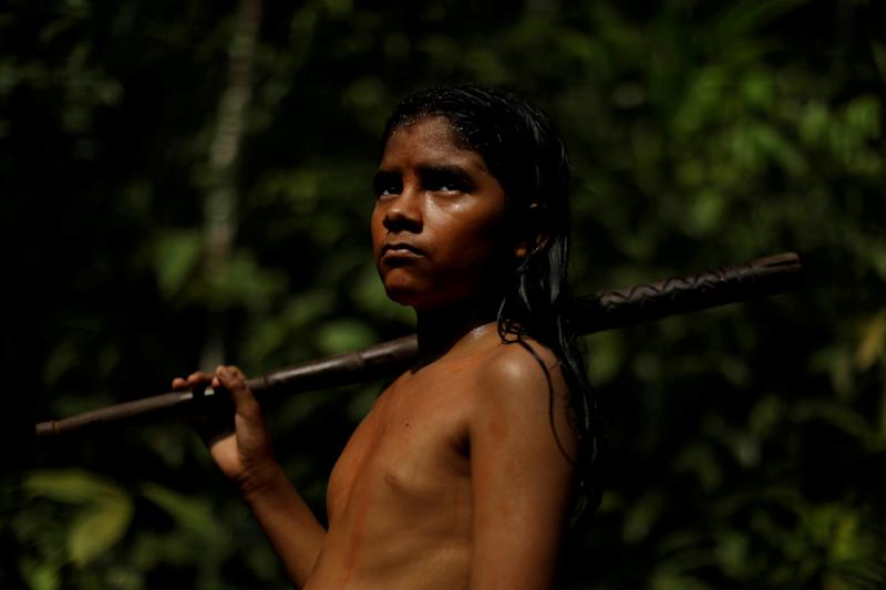 REFILE - REMOVING EXTRA CHARACTERS An indigenous named Pedro Mura from the Mura tribe reacts in front a deforested area in nondemarcated indigenous land inside the Amazon rainforest near Humaita, Amazonas State, Brazil August 20, 2019. Picture taken August 20, 2019. REUTERS/Ueslei Marcelino