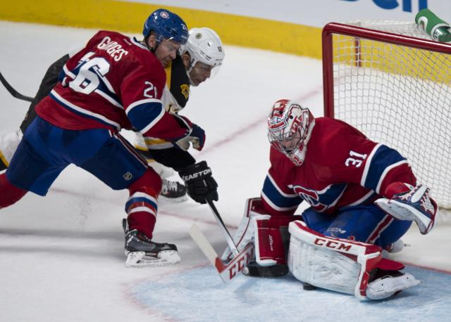 Montreal Canadiens goalie Carey Price stops a shot by Boston Bruins' Jarome Iginla as Canadiens defenseman Josh Gorges covers during third period NHL hockey action Thursday, Dec. 5, 2013, in Montreal. The Canadiens beat the Bruins 2-1. (AP Photo/The Canadian Press, Paul Chiasson)