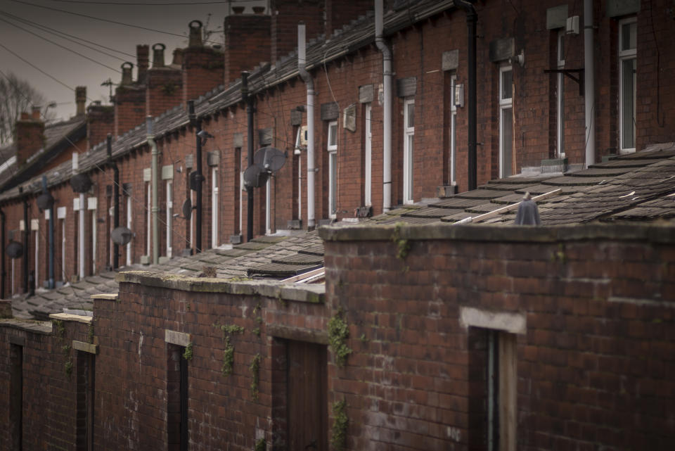BOLTON, UNITED KINGDOM - FEBRUARY 09:  A general view of terraced houses and the back alleys of homes in Bolton on February 9, 2015 in Bolton, United Kingdom. As the United Kingdom prepares to vote in the May 7th general election  many people are debating some of the many key issues that they face in their life, employment, the NHS, housing, benefits, education, immigration, 'the North South divide, austerity, EU membership and the environment.  (Photo by Christopher Furlong/Getty Images)