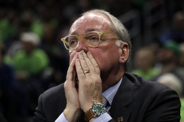 FILE - In this April 1, 2019, file photo, Notre Dame Vice President and Director of Athletics Jack Swarbrick watches during the first half of a regional championship game between Notre Dame and Stanford in the NCAA women's college basketball tournament in Chicago. The goal is to have all 130 major college football teams start the upcoming season at the same time _ whether that's around Labor Day weekend as scheduled or later _ and play the same number of games. With each passing day it is becoming apparent the COVID-19 pandemic is going to make that goal difficult to achieve. (AP Photo/Nam Y. Huh, File)