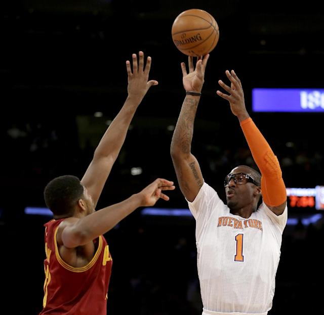New York Knicks' Amar'e Stoudemire, right, shoots over Cleveland Cavaliers' Tristan Thompson during the first half of the NBA basketball game at Madison Square Garden, Sunday, March 23, 2014, in New York. (AP Photo/Seth Wenig)
