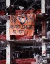 """FILE - In this April 30, 1995, file photo, a banner placed by the Dade County (Fla.) search and rescue team, saying """"We Love You Oklahoma City,"""" hangs from a floor of the bomb-devastated Alfred P. Murrah Federal Building in Oklahoma City. The team assisted in the search for victims of the attack. Search and rescue teams from Miami-Dade have been described as among the best and most experienced in the world. (AP Photo/Amy Sancetta, File)"""