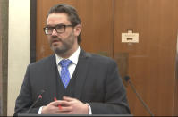 In this image from video, defense attorney Eric Nelson questions Dr. David Fowler as Hennepin County Judge Peter Cahill presides, Wednesday, April 14, 2021, in the trial of former Minneapolis police Officer Derek Chauvin at the Hennepin County Courthouse in Minneapolis, Minn. Chauvin is charged in the May 25, 2020 death of George Floyd. (Court TV via AP, Pool)