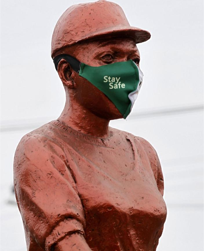 On Monday a number of statues in Nigeria's biggest city, Lagos, are seen with face masks as a reminder to the general public