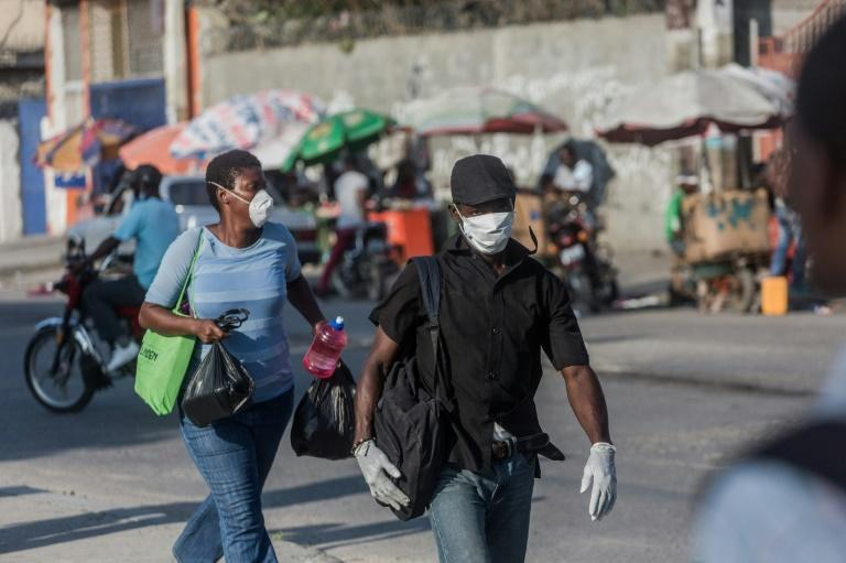Haiti has reported its first cases of the novel coronavirus -- its spread in the region is endangering patients who need vital medical care in other countries such as Cuba (AFP Photo/Pierre Michel Jean)