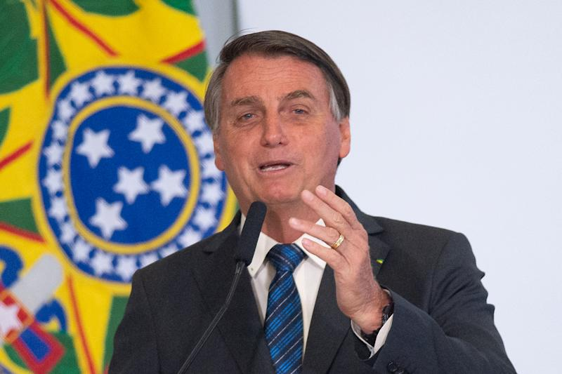 BRASILIA, BRAZIL - OCTOBER 14: Jair Bolsonaro, President of Brazil, speaks during the launching of Programa Genomas Brazil amidst the coronavirus (COVID-19) pandemic at the Planalto Palace on Octuber 14, 2020 in Brasilia. Brazil has over 5.140,000 confirmed positive cases of Coronavirus and has over 151,747 deaths. (Photo by Andressa Anholete/Getty Images)