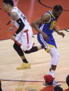 Golden State Warriors forward Kevin Durant (35) goes down injured while playing against the Toronto Raptors during first-half basketball action in Game 5 of the NBA Finals in Toronto, Monday, June 10, 2019. (Nathan Denette/The Canadian Press via AP)