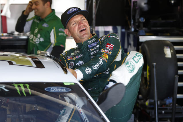Clint Bowyer gets in his car during practice for a NASCAR Cup Series auto race at Michigan International Speedway in Brooklyn, Mich., Saturday, Aug. 10, 2019. (AP Photo/Paul Sancya)