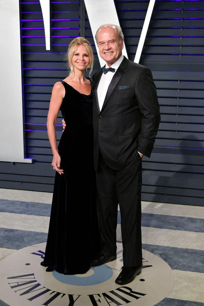 """<p>Kelsey Grammer married his fourth wife, Kayte Walsh, in 2011. Walsh, a former flight attendant, met the <em>Fraiser</em> actor while he was performing in <em>La Cage aux Folles </em>in New York City—and married to Camille Grammer. The couple said """"I do"""" <a href=""""https://www.popsugar.com/celebrity/photo-gallery/39681651/image/39862964/Kayte-Walsh"""" rel=""""nofollow noopener"""" target=""""_blank"""" data-ylk=""""slk:just two weeks after his divorce was finalized"""" class=""""link rapid-noclick-resp"""">just two weeks after his divorce was finalized</a>. </p>"""