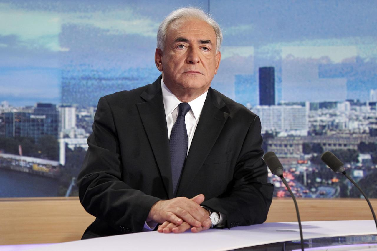 "Dominique Strauss-Kahn, former head of the International Monetary Fund, looks on prior to a television interview at the TV news broadcast by French TV station TF1, in Boulogne-Billancourt, outside Paris, Sunday Sept. 18, 2011. Strauss-Kahn has dismissed French writer Tristane Banon's claims that he tried to rape her during a 2003 interview as ""imaginary"" and insisted there was ""no act of aggression, no violence."" (AP Photo/Francois Guillot, pool)"