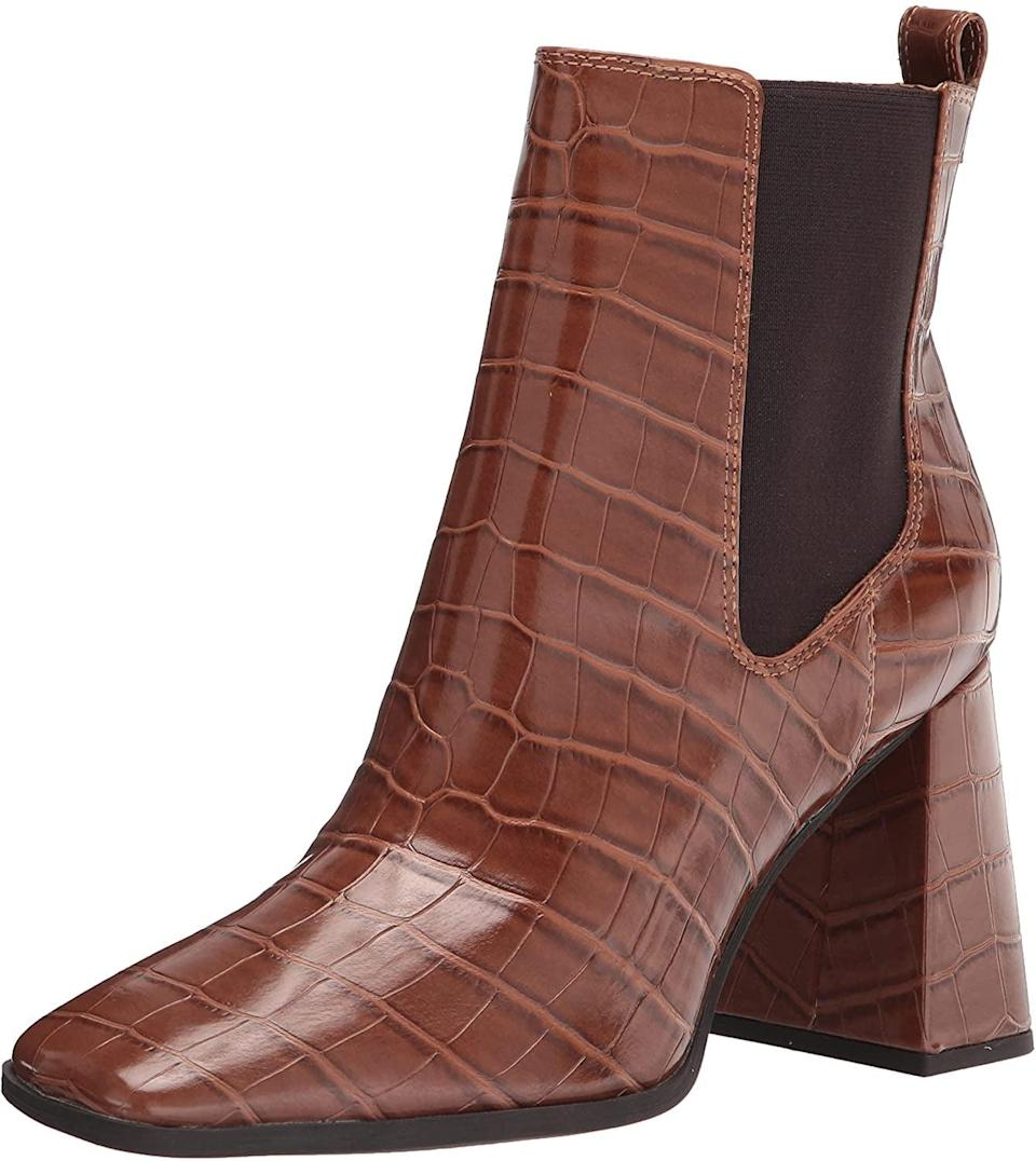<p>Whether you pair them with flared jeans or tights and your favorite frock, prepare to get a lot of mileage out of these <span>Circus by Sam Edelman Women's Polly Ankle Boots</span> ($55). With a faux embossed exterior and chunky heel, it's safe to say these boots are made for walking. (Stylishly, of course.)</p>