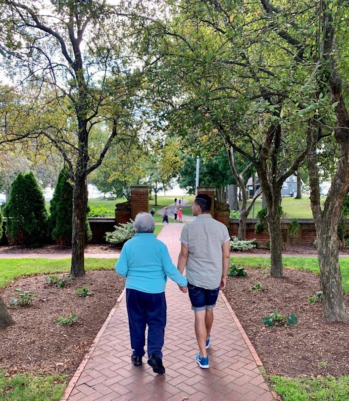 Juanita Lopez walks with her son, Juan Lopez, in this 2019 photo, the last walk they took together. She died of COVID-19 in April 2020.