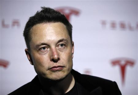 Tesla Motors Inc CEO Musk talks about Tesla's new battery swapping program in Hawthorne