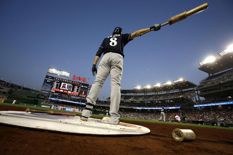 """File-This Sept. 21, 2012 file photo shows Milwaukee Brewers Ryan Braun warming up before the first inning of a baseball game against the Washington Nationals at Nationals Park, in Washington. Braun, a former National League MVP , has been suspended without pay for the rest of the season and admitted he """"made mistakes"""" in violating Major Leauge Baseball's drug policies. MLB Commissioner Bud Selig announced the penalty Monday July 22, 2013, and released a statement by the Milwaukee Brewers slugger, who said: """"I am not perfect. I realize now that I have made some mistakes. I am willing to accept the consequences of those actions."""" (AP Photo/Jacquelyn Martin, File)"""