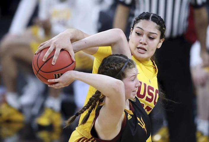 Southern California forward Alissa Pili (35) steals the ball from Arizona State guard Maggie Besselink (13) during an NCAA college basketball game in the first round of the Pac-12 women's tournament Wednesday, March 3, 2021, in Las Vegas. (AP Photo/Isaac Brekken)