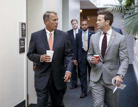 """**In this file photo from Jan. 9, 2015, Speaker of the House John Boehner, R-Ohio, left, walks with Rep. Aaron Schock, R-Ill., as House Republicans head to a closed-door GOP strategy meeting at the Capitol in Washington, Friday, Jan. 9, 2015. Schock has hired top lawyers and public relations experts in the wake of recent questions surrounding his travel and entertainment expenses. Schock, a rising Republican star already facing an ethics inquiry, had spent taxpayer and campaign funds on flights aboard private planes owned by some of his key donors, an Associated Press review found. There have also been other expensive charges, including for a massage company and music concerts. Schock's high-flying lifestyle, combined with questions about expenses decorating his office in the style of the TV show """"Downton Abbey,"""" add to awkward perceptions on top of allegations he illegally solicited donations in 2012. The Office of Congressional Ethics said in a 2013 report that there was reason to believe Schock violated House rules by soliciting campaign contributions during a 2012 primary. (AP Photo/J. Scott Applewhite/File)"""