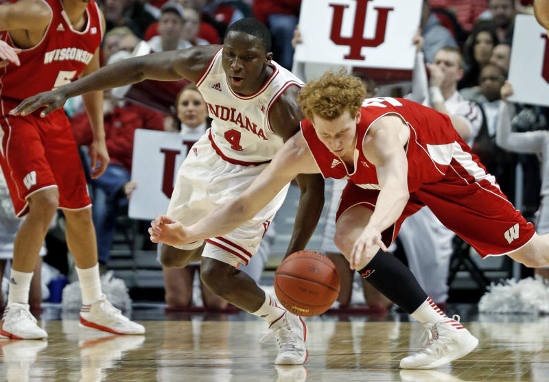 Wisconsin's Mike Bruesewitz and Indiana's Victor Oladipo (4) go after a loose ball during the first half of an NCAA college basketball game at the Big Ten tournament Saturday, March 16, 2013, in Chicago. (AP Photo/Charles Rex Arbogast)
