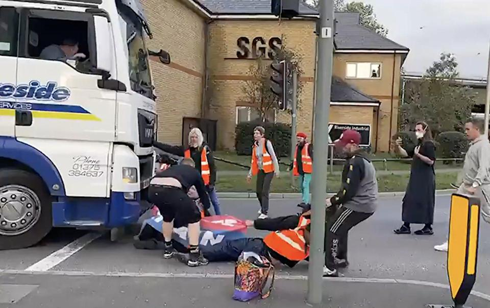 An Insulate Britain protester is dragged from the road by a driver - LBC