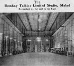Established in 1934 by Himanshu Rai and Devika Rani, the first lady of Indian cinema, Bombay Talkies was the first corporate studio in India, listed in the Bombay Stock Exchange. It was also the launching pad for legendary artists such as Madhubala, DIlip Kumar, Raj Kapoor, Mehmood and Lata Mangeshkar. The studio was equipped with the latest international technology, complete with sound and echo-proof stages, editing rooms, laboratories and a preview theatre. The studio also saw many romances, heartbreaks and successes during its time, while it gave the country India's first male star – Ashok Kumar. Over the years, Bombay Talkies produced films such as Jeevan Naiya, Kismet, Mahal, Ziddi and Achhut Kanya, one of the most acclaimed films of all which broached the controversial topic of love between a lower class girl and a Brahmin man. After Rai's death in 1940, Rani took over the studios and ran it till her retirement post her marriage to Russian artist Svetoslav Roerich. After she left, though, the studio's fortunes declined. Ashok Kumar, who had left Bombay Talkies to set up his own studio called Filmistan, returned to his old studio and, along with talent producer Savak Vacha and German cinematographer Josef Wirsching, tried to revive it. However, despite several attempts, they failed and it was finally sold to Tolaram Jalan, a businessman. Badban, featuring Dev Anand, Ashok Kumar and Meena Kumari was the last film produced by Bombay Talkies, before it shut down in 1954.