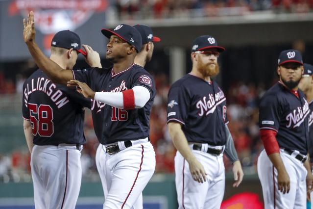Washington Nationals' Victor Robles is introduced for Game 3 of the baseball National League Championship Series against the St. Louis Cardinals Monday, Oct. 14, 2019, in Washington. (AP Photo/Jeff Roberson)