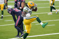 Green Bay Packers running back Jamaal Williams (30) celebrates after running for a gain as Houston Texans cornerback Phillip Gaines (29) is seen in the background during the second half of an NFL football game Sunday, Oct. 25, 2020, in Houston. (AP Photo/Sam Craft)