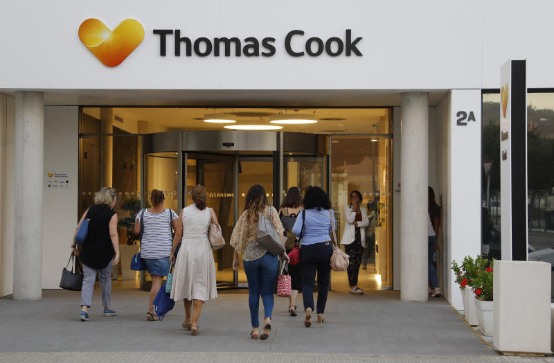 Thomas Cook workers enter the headquarters in the morning on September 24, 2019 in Mallorca, Spain. Photo: Clara Margais/Getty Images