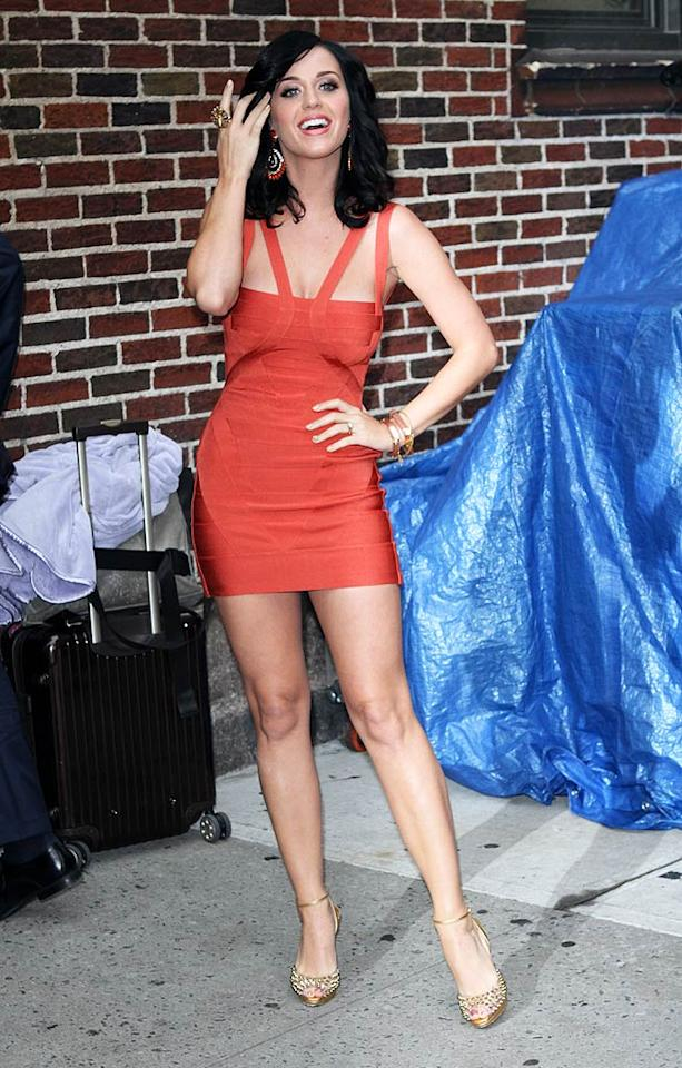 "Meanwhile in NYC, pop tart Katy Perry popped by the Ed Sullivan Theater to promote her new album, <i>Teenage Dream</i>, on ""Late Show With David Letterman"" in a $1,950 curve-hugging, coral-colored Herve Leger bandage dress and spiked Louboutins. Richie Buxo/<a href=""http://www.splashnewsonline.com"" target=""new"">Splash News</a> - August 24, 2010"